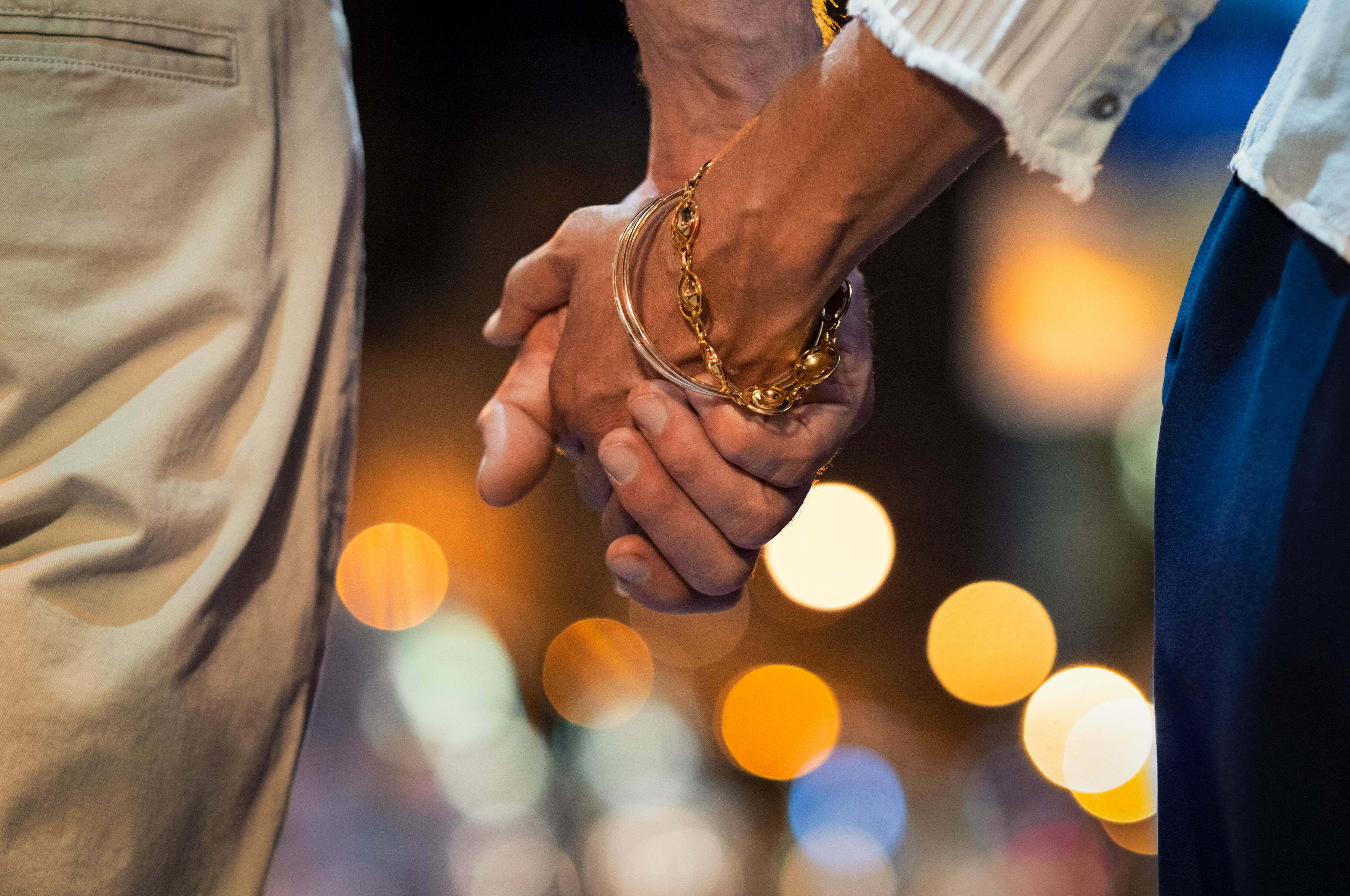 couple over age 55 holding hands on a date